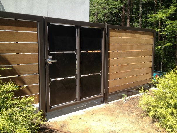 Contemporary Privacy Fence with Ipe and Patinated Steel | David ...